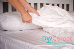 changing-bedsheets-mattress-cleaning-dw-carpet-cleaning-singapore