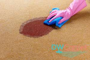 large-red-stain-on-brown-rug-cleaning-dw-carpet-cleaning-singapore