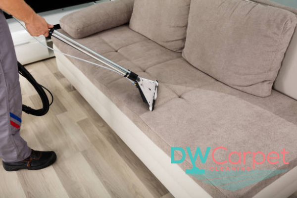 man-wiping-dusty-fabric-sofa-cleaning-dw-carpet-cleaning-singapore