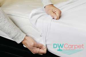 mattress-protector-being-placed-mattress-cleaning-dw-carpet-cleaning-singapore