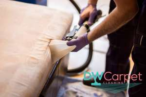 professional-worker-vaccuming-mattress-cleaning-dw-carpet-cleaning-singapore