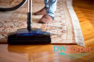 vacuuming-rug-with-fringes-rug-cleaning-dw-carpet-cleaning-singapore