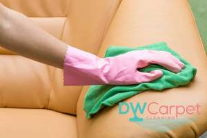 wiping-sofa-with-green-cloth-sofa-cleaning-dw-carpet-cleaning-singapore