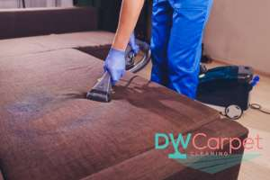worker-vaccuming-fabric-sofa-cleaning-dw-carpet-cleaning-singapore