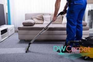 worker-vacuuming-grey-carpet-cleaning-dw-carpet-cleaning-singapore